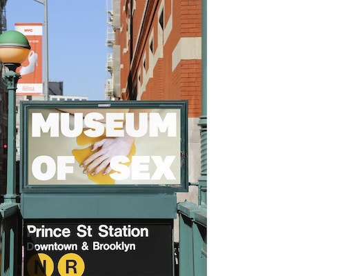 A banner designed for the Museum of Sex on an advertising panel at the entrance of a subway station