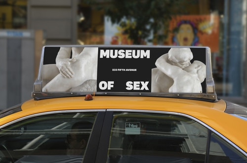 A banner for the Museum of Sex campaign on a taxi sign