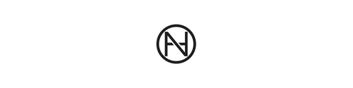 The monogram logo designed for Neuehouse consisting of the letter N style into a circle