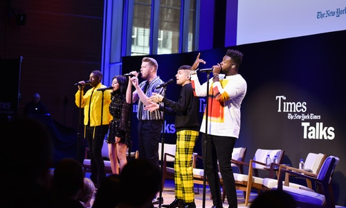 The music group Pentatonix performing on the stage after a talk