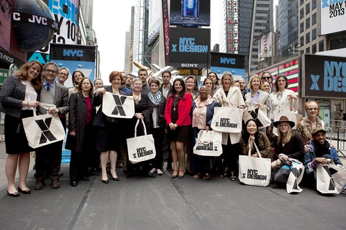 People in Time Square holding bags branded with the visual identity of NYC x Design