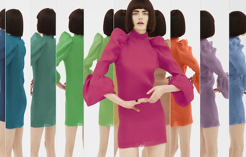 A model wearing a pink dress surrounded by a range of mirror whose reflections show her in a different coloured dress
