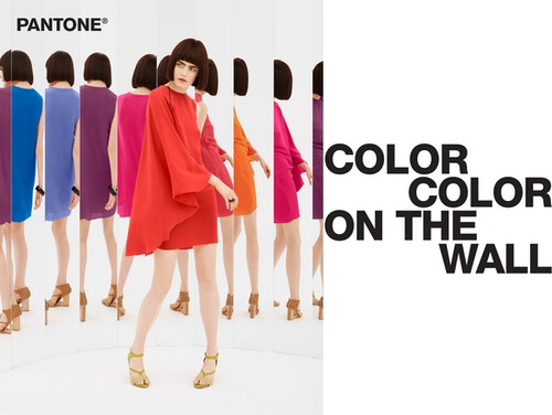 """A model wearing different coloured dresses with the quote """"Color on the wall"""""""