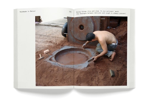 A opened book with the picture of a man working with soil