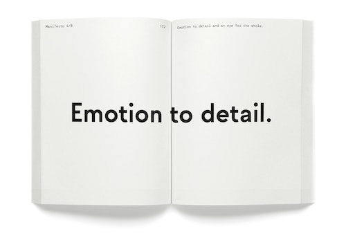 "A opened book with the quote ""Emotion to detail"""