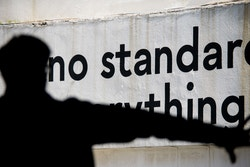 "A copywriting quoting ""no standard"" on a concrete wall"