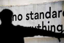 "A copywriting quoting ""no standard"" on a concrete wall"