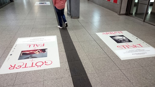 Two posters designed for Ruhrtriennale taped to the floor of a lane