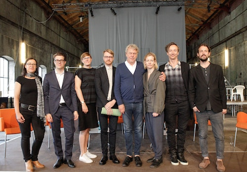 The team of Ruhrtriennale dressed-up pausing together