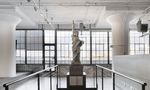 A small-sized Lady Liberty sculpture in the middle of Starrett Lehigh's hall