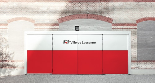 The new visual of the City of Lausanne applied on public doors