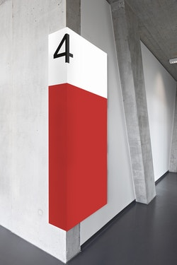 Signage made for the City of Lausanne applied in a hallway corner