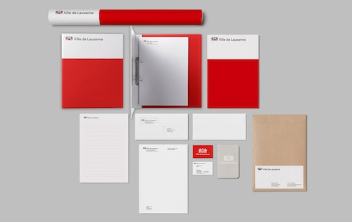 Different printed materials developed for City of Lausanne branding on a table